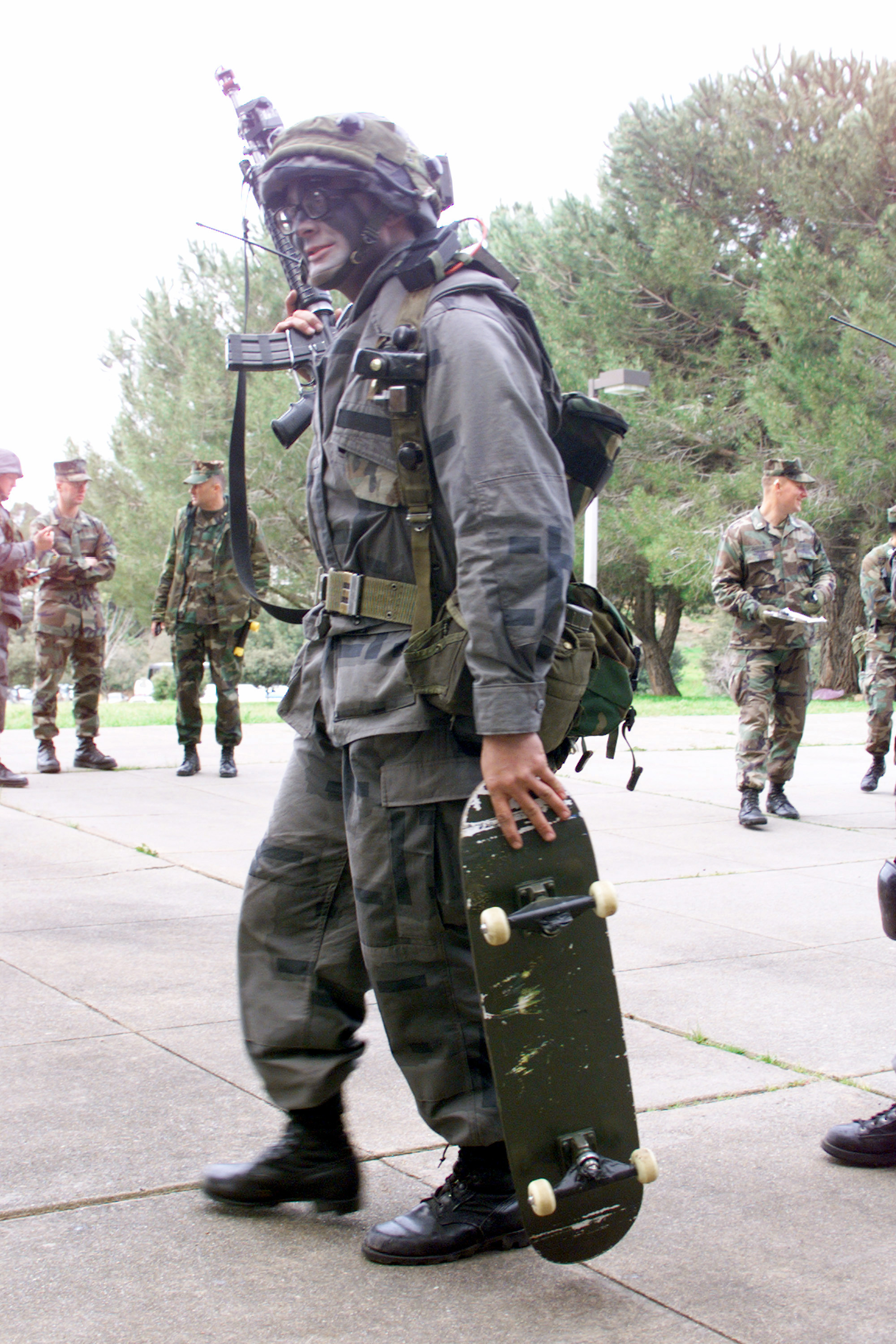 A soldier with a skateboard.