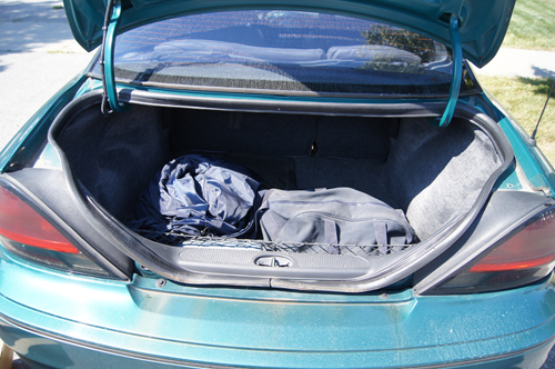 Bug out bag in the trunk of a car