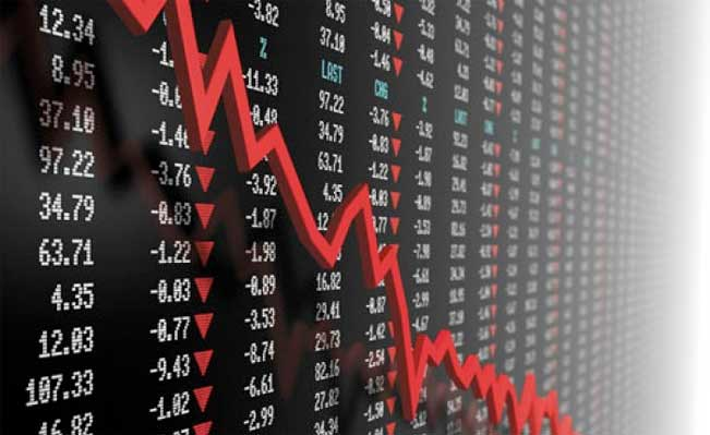 Stock market board covered in losses with downwards pointing arrow.