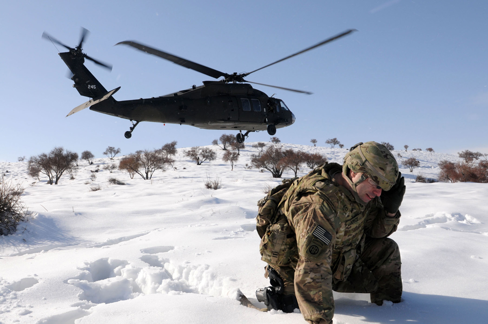 Soldier and helicopter in snow